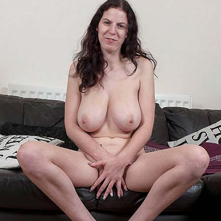 Busty Summer Jay gets nude to give a boobjob