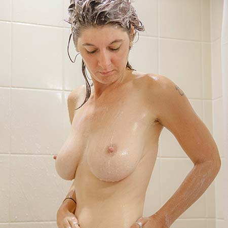 Busty Ashlynn Brooks takes a shower