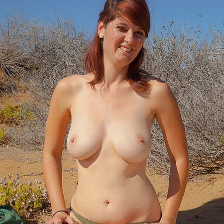 Busty redhead Ashlynn Brooks strips outside