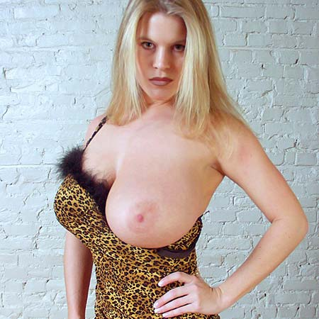 Taryn's big tits pop out of her leopard dress