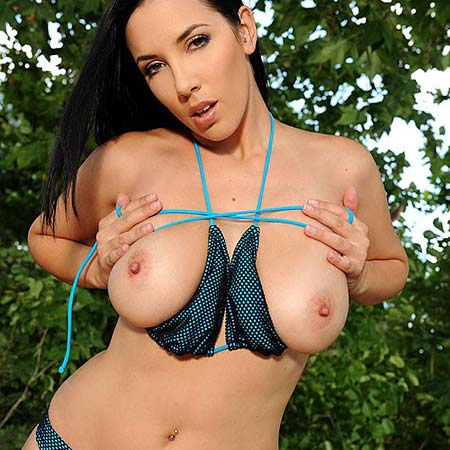 Busty Jelena Jensen strips out of denim shorts