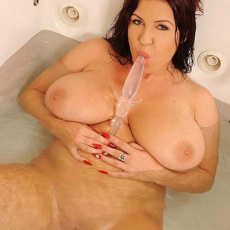 Big titted Kora toys herself in the tub