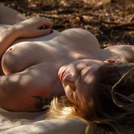 Cute Madison Sage undressed in nature