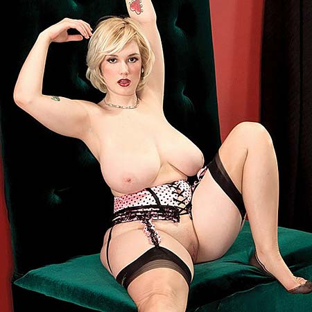Busty blonde Siri looks hot in stockings and lingerie